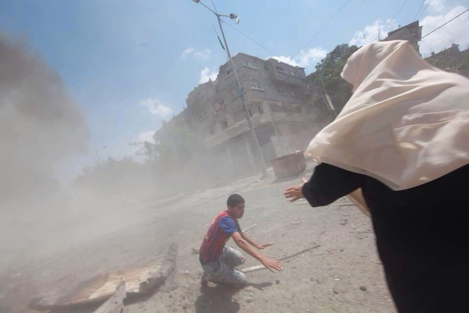 Palestinian woman rescues boy