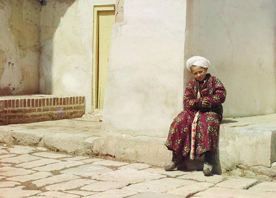 1 A boy sits in the court of Tillia-Kari mosque in Samarkand, present-day Uzbekistan, ca. 1910