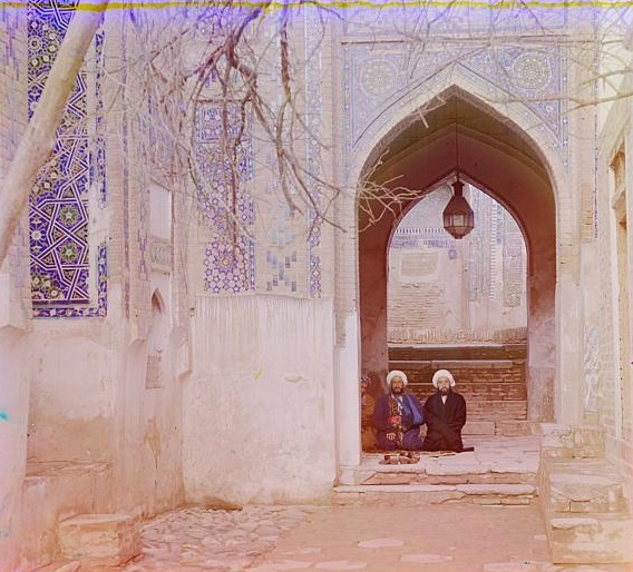 16 men sitting in a mosque in samarkand