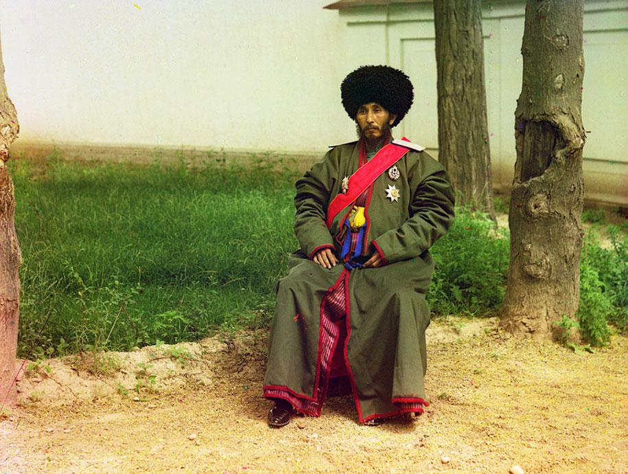 5 Isfandiyar Jurji Bahadur, Khan of the Russian protectorate of Khorezm (Khiva, now a part of modern Uzbekistan), full-length portrait, seated outdoors, ca. 1910