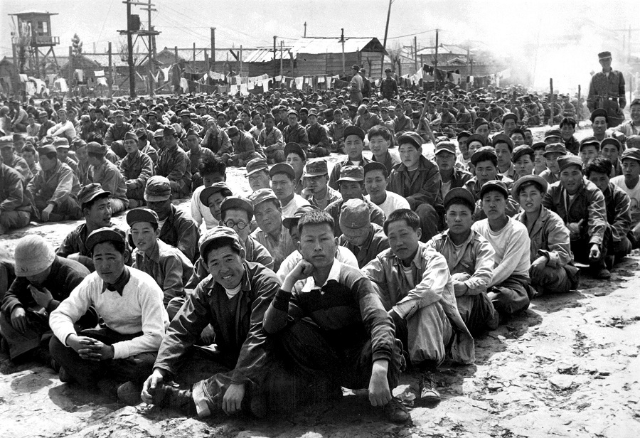 At the United Nations' prisoner-of-war camp at Pusan, prisoners are assembled in one of the camp compounds. The camp contains both North Korean and Chinese Communist prisoners. April 1951. Gahn, State Dept. (USIA) Exact Date Shot Unknown NARA FILE #: 306-PS-51-7134 WAR & CONFLICT BOOK #: 1496